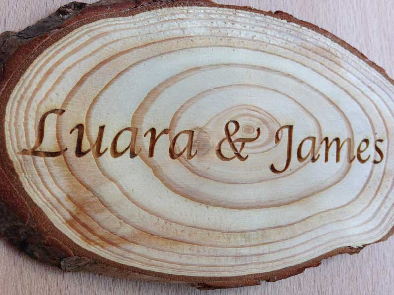 wooden log slices engraved wedding favours