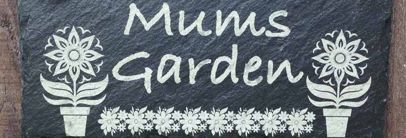 slate garden signs with flower pot
